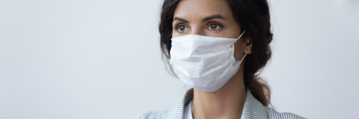 Banner horizontal view of young woman wearing medical protective mask from coronavirus pandemic...