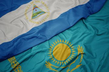 Deurstickers Noord Europa waving colorful flag of kazakhstan and national flag of nicaragua.