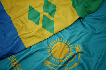 Deurstickers Noord Europa waving colorful flag of kazakhstan and national flag of saint vincent and the grenadines.