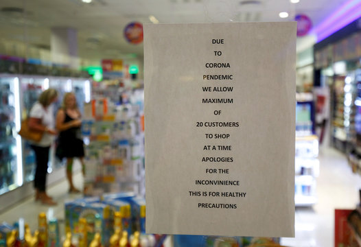 A sign in a pharmacy tells customers of restrictions ahead of the 21st day of a nationwide lockdown in an attempt to contain the coronavirus disease (COVID-19) outbreak in Hillcrest