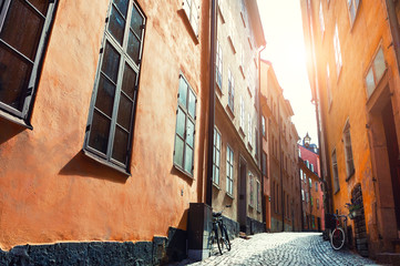 Beautiful street at sunset in Old Town of Stockholm, Sweden. Famous travel destination