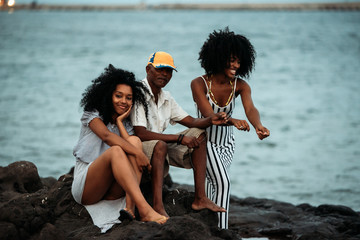 Father and daughters fishing together