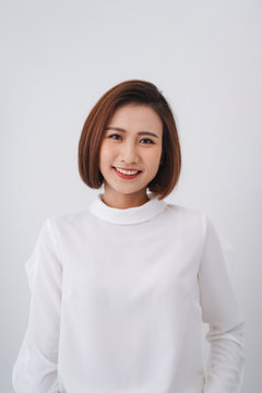 Confident young beautiful asian business woman on white background