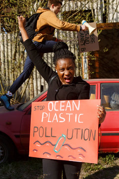 Black woman screaming during environmental protest