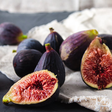 Whole and cut mission figs on canvas and slate