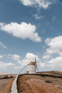 Authentic stone mills with with wooden wind turbines