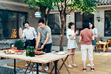 Mature couple barbecuing at yard