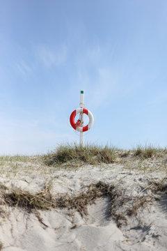 Life buoy on dune