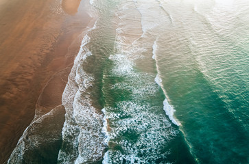 Aerial view of a wild beach at sunset Fotobehang