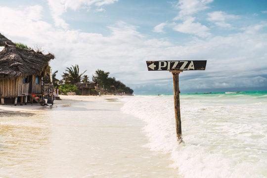 Isolated pizza sign on the zanzibar beach