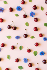 Seamless pattern with cherries, lemon balm leaves and cornflower