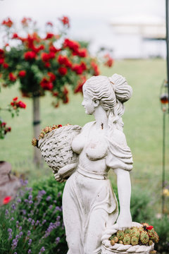Statue of woman in the garden