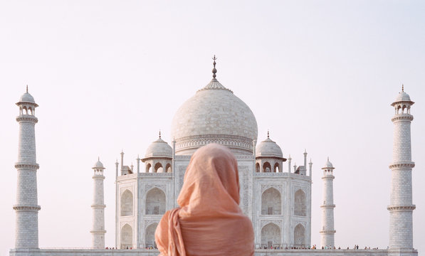 Rear view of woman standing in front of Taj Mahal