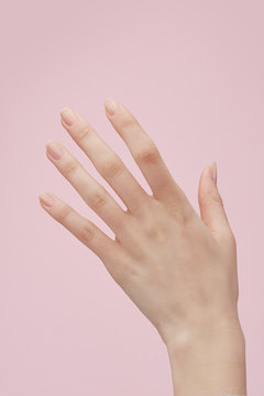 Hand against pink background