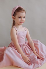 Charming girl in pink dress