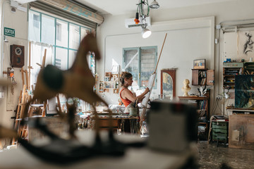 Artist woman drawing in her studio.