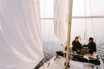Couple in sailboat on lake