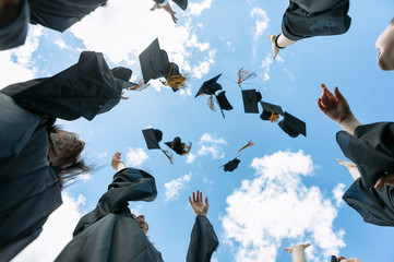 Grad: Recent Graduates Toss Their Caps In The Air