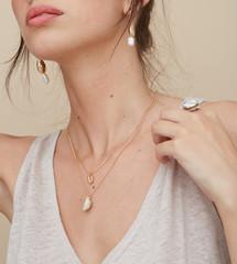Detail woman wearing shell jewellery