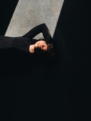 Overhead view of woman with eyes closed lying on wooden floor