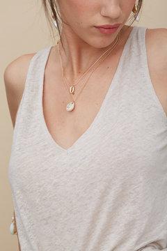 Closeup woman wearing shell jewellery