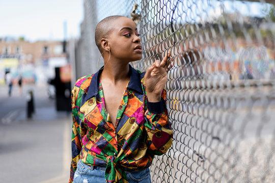 Stylish afro woman having fun in the city