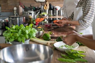 Women preparing vegetables in a kitchen school