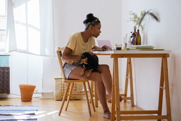 Cool African American woman sitting at her workind desk