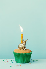 Birthday cake with golden rabbit candle holder