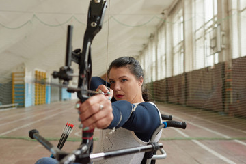 Disabled Female Archer Shooting
