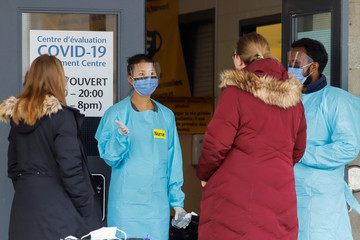 A nurse greets patients outside a coronavirus disease (COVID-19) assessment center in Ottawa