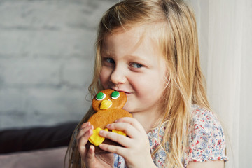 Child eating gingerbread biscuit