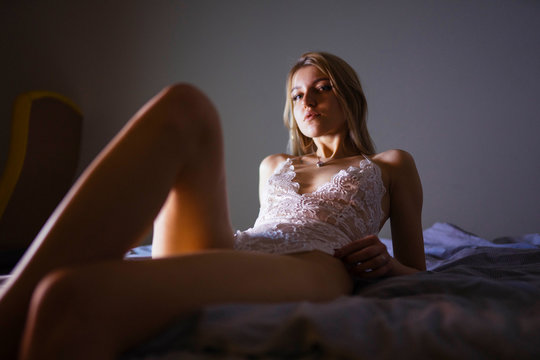 woman lying on bed in the evening