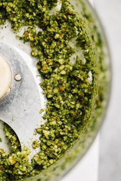 Making basil pesto macro closeup