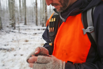 Male hunter checks his GPS while hunting in Colorado.