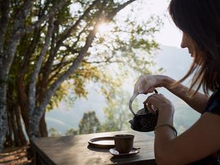 Woman Drinking Tea In Garden