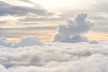Beautiful view from above clouds at dusk Fotobehang