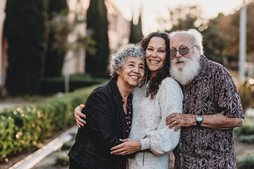 Portrait of active senior married couple and adult daughter smiling