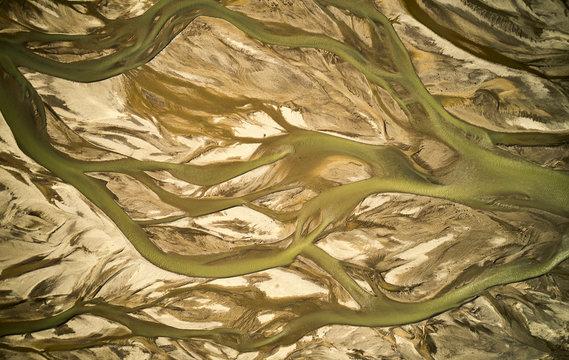 Muddy stream in mountainous terrain