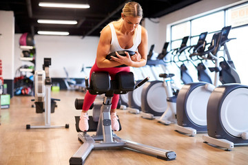 A woman working out in the gym.