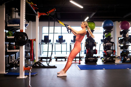 An athletic woman putting in time at the gym.