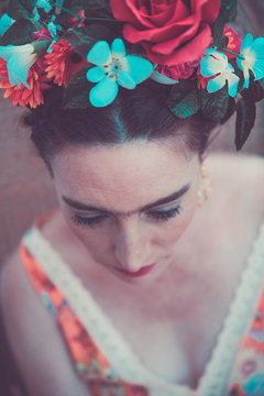Adult woman dressed and made up like Frida