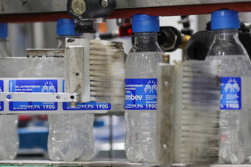 A machine labels bottles of ethanol-based hand sanitizers in AGE do Brasil factory, hired by brewing Ambev to produce hand sanitizers to donate to public hospitals during the coronavirus disease (COVID-19) outbreak in Vinhedo