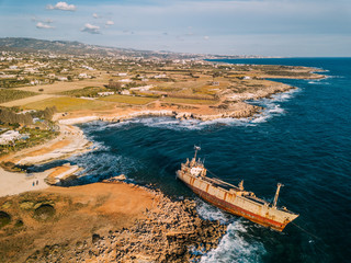 Poster Shipwreck Aerial drone view ship wreck on the beach. Pegeia near Paphos on Cyprus.