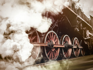 vintage trains with a steam on the move