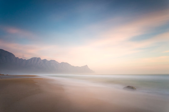 Wide angle view of a stunning sunset at Kogelbay just outside Gordonsbay in cape town south africa