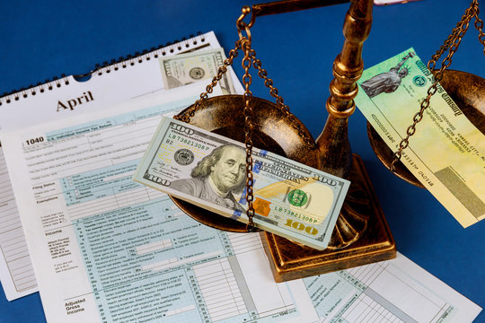 Individual Income Tax Return Law concept scales of justice criminal liability for non-payment of taxes of one hundred dollars bill form 1040 on U.S.