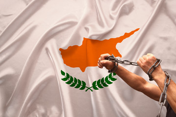 Fotobehang Cyprus male hands of a prisoner in iron chains against background of the national flag of cyprus on a beautiful silk fabric, the concept of political repression, crime, imprisonment, violation of the rights