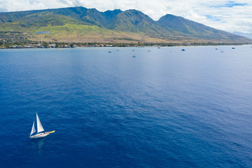Wall Mural - Sail boat in hawaii with mountains