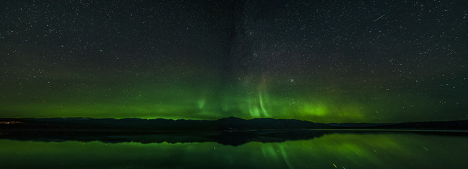 Aurora Borealis Northern Lights seen in Yukon Territory, Canada. Fall autumn in Yukon.